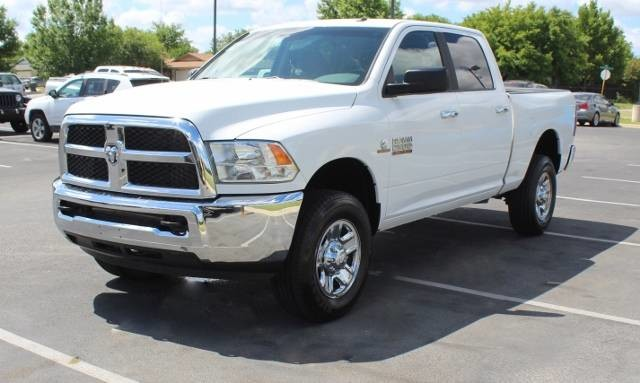 PRE-OWNED 2017 RAM 2500 SLT FOUR WHEEL DRIVE STANDARD BED